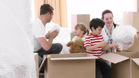 real : Young family unpacking goods atfter moving house Stock Footage