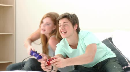 eğlence oyunları : Teenager Playing a video Game at home. Recorded on 1080p
