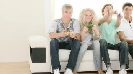дичь : Teenagers Playing Video Games at home. Recorded in HD1920x1080p