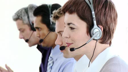temsilci : Positive business people in a call center with headset on