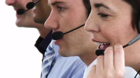 fejhallgató : Concentrated business people with headset on working in a callcenter Stock mozgókép