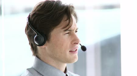forródrót : Charming businessman working in a call center in a company