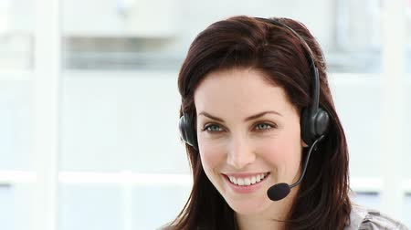 yardım hattı : Assertive businesswoman working in a call center in a company Stok Video
