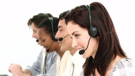 képviselő : Business team working in a call center against a white background