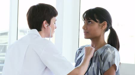 exam : Female doctor examining a patient in her practice Stock Footage