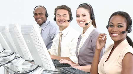 fejhallgató : International customer service representatives using headset in a call center Stock mozgókép