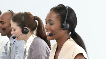 телемаркетинг : Young customer service representatives using headset in a call center