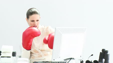 bokszoló : Confident businesswoman wearing boxing gloves in her office Stock mozgókép