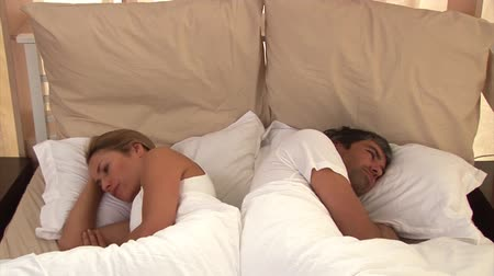 disinterest : Bored couple sleeping together at home Stock Footage