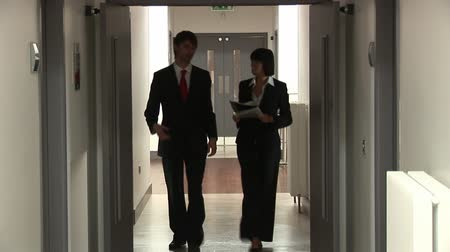 agreement : Royalty Free Stock Footage of Business People Walking in a Corridor