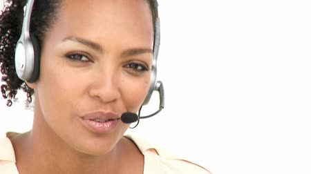 temsilci : Attractive businesswoman working in a call center against a white background