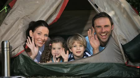gerekçesiyle : Family smilling at the camera in a tent in the Park Stok Video