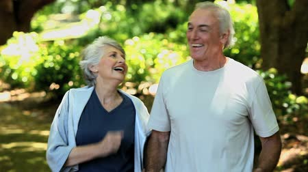 jogging : Elderly couple taking a break after running in a Forest