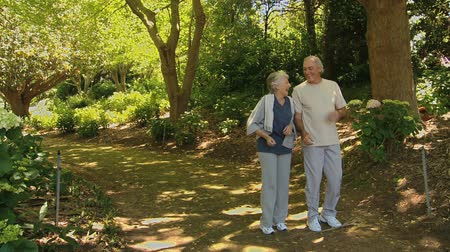 jogging : Senior man and woman taking a break after running in a Forest Stock Footage