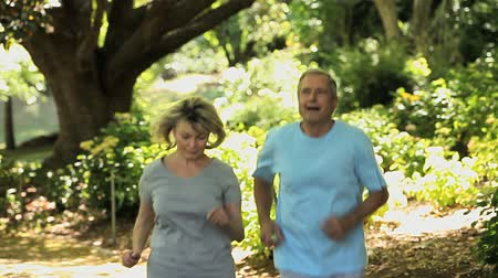 idősek : Old woman and her husband running in the Forest Stock mozgókép
