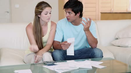 banknoty : A couple doing their accounts in the living room