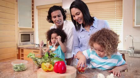 family life : Young family preparing salad