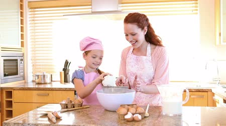 yapıştırma : Mother and daughter cooking in the kitchen Stok Video