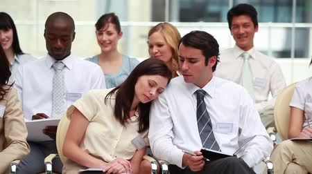 sleep : Woman sleeping on her colleagues shoulder at a meeting