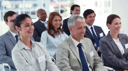 Audience nodding and applauding at a conference Stock Footage