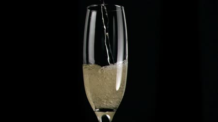 sıçrama : Champagne poured in super slow motion in a glass Stok Video