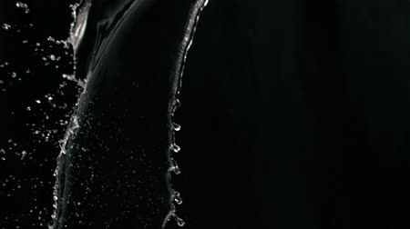 kapička : Liquid splashes in super slow motion against black background