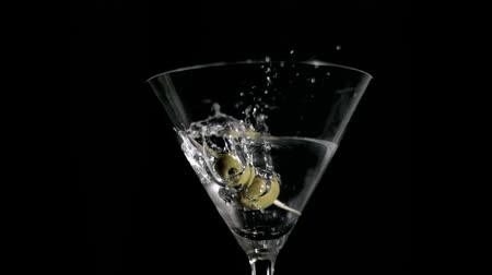 martini glasses : Olives falling in super slow motion in a cocktail Stock Footage