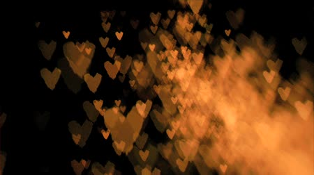 heart shaped : Heart-shaped sparks flying in super slow motion against a black background