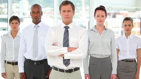 redhead suit : Business team standing together in a serious manner