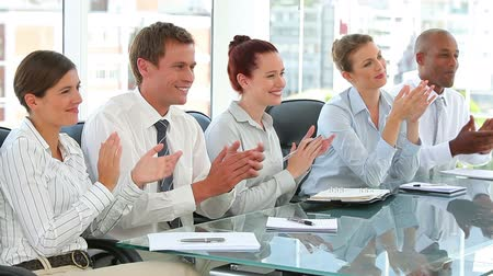 redhead suit : Business team taking notes in a meeting together Stock Footage
