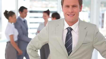redhead suit : Business man with hands on his sides smiling Stock Footage