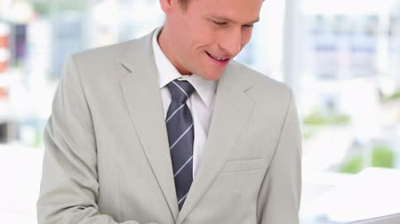 redhead suit : Business man using his laptop and smiling Stock Footage