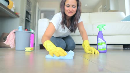cleaning products : Video of brunette woman scrubbing the living room floor at home Stock Footage