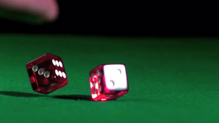 прокатка : Hand rolling pink dice in slow motion