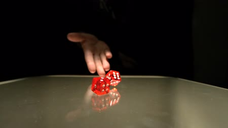 dobókocka : Hand throwing two red dice in slow motion