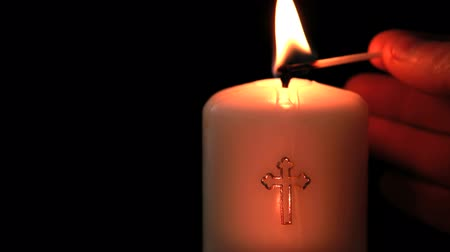 jehovah witness : Candle with cross embellishment on black background
