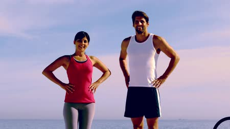 fit : People wearing sportswear on the beach and posing in slow motion