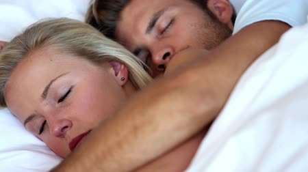 napping : Couple cuddling in bed and sleeping peacefully