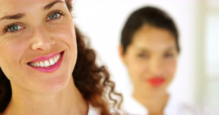 smile : Smiling businesswoman with colleague behind her in the office Stock Footage