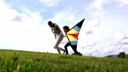 kopec : Woman and her daughter running with kite in slow motion