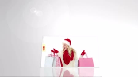 eladás : Digital animation of christmas sale advertisement with snow falling on forest Stock mozgókép