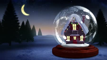 pré natal : Digital animation of Cute christmas house inside snow globe
