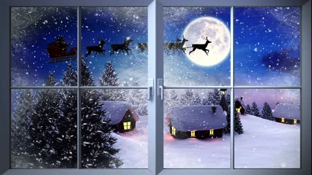 obec : Digital animation of Santa flying past window in the snow