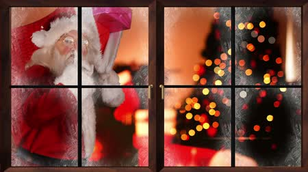 pré natal : Digital animation of Santa delivering presents in a home