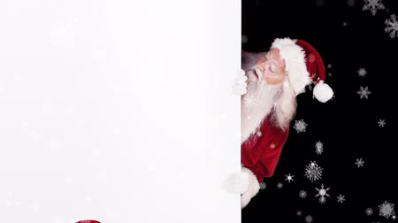 подарок : Digital animation of Santa peeking around gift card on festive background Стоковые видеозаписи