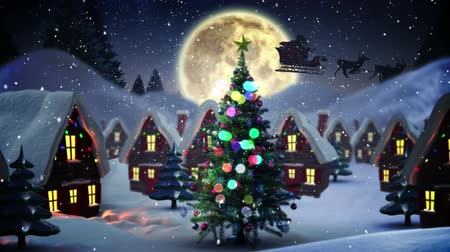 ren geyiği : Digital animation of Flashing christmas tree in snowy village Stok Video