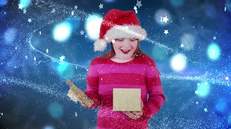surprised : Digital animation of Festive little girl opening magical christmas gift