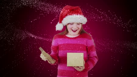 presentes : Digital animation of Festive little girl opening magical christmas gift