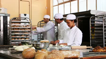 mutfak : Team of bakers working together in commercial kitchen