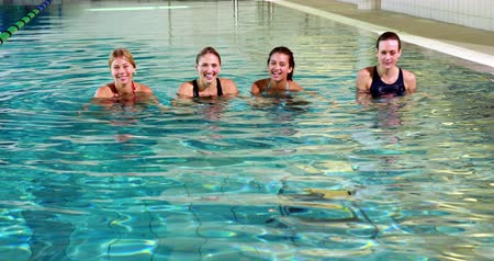 atlet : Fit women doing aqua aerobics in the leisure center